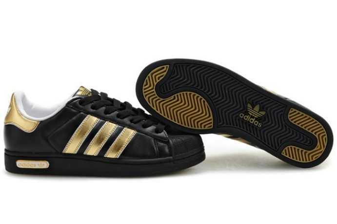Promotion de groupe chaussure adidas noir et dore.Dédié à